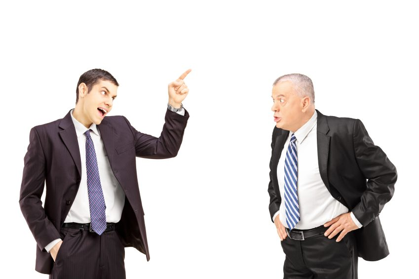 Angry business colleagues during an argument isolated on white background